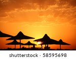 Beach Umbrellas And Sunset