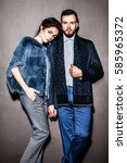 young fashion couple posing for ... | Shutterstock . vector #585965372