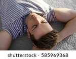 happy young man lying on soft... | Shutterstock . vector #585969368