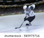 ice hockey player in action... | Shutterstock . vector #585975716