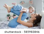 young mother holding her... | Shutterstock . vector #585983846