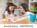 mother with her child having... | Shutterstock . vector #585998702
