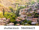 mountain village of palaichori. ... | Shutterstock . vector #586006625