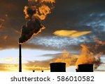 industrial view. golden smoke... | Shutterstock . vector #586010582