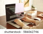 woman working on computer at... | Shutterstock . vector #586062746