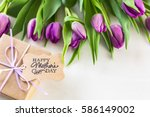 small gift and purple tulips... | Shutterstock . vector #586149002