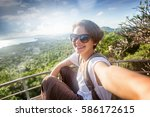 young woman traveler in... | Shutterstock . vector #586172615