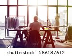 fashion designer working on her ... | Shutterstock . vector #586187612