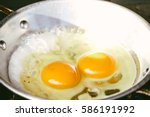 fried egg in a frying pan with... | Shutterstock . vector #586191992