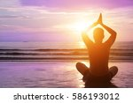 calm young man meditating at... | Shutterstock . vector #586193012