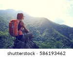 successful young woman hiker... | Shutterstock . vector #586193462