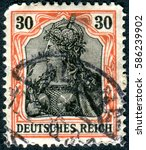 Small photo of GERMANY - CIRCA 1902: A stamp printed in Germany (Deutsches Reich), shows a allegory Germania with imperial crown, circa 1902