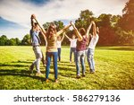 group of friends making a... | Shutterstock . vector #586279136
