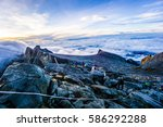 hikers hiking up mount kinabalu ... | Shutterstock . vector #586292288