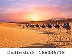 camel caravan going through the ... | Shutterstock . vector #586336718