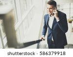 handsome businessman using... | Shutterstock . vector #586379918