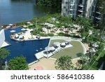cassia hotel   phuket  ... | Shutterstock . vector #586410386