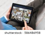 man looking at home security... | Shutterstock . vector #586486958