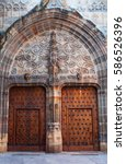 Small photo of Bilbao, Spain, 25/01/2017: details of the wooden door of the Cathedral Basilica of Santiago, the catholic church in the Old Town built in Gothic style between the XIV century and the XVI century