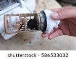 coins in washing machine's... | Shutterstock . vector #586533032