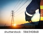 engineer and high voltage pole | Shutterstock . vector #586540868