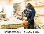 young woman using a screwdriver ... | Shutterstock . vector #586571102