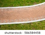 Looking Down On A Brick Walkwa...