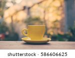 cup of coffee on table in the... | Shutterstock . vector #586606625