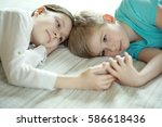 boy and girl looking at a smart ... | Shutterstock . vector #586618436