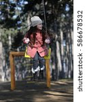 Small photo of Child on a swing