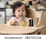 cute baby girl brushing her... | Shutterstock . vector #586702136