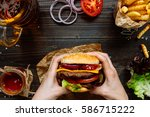 hands holding fresh delicious... | Shutterstock . vector #586715222