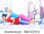 fitness instructor at the gym | Shutterstock . vector #586722572