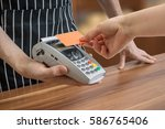 customer is paying with... | Shutterstock . vector #586765406