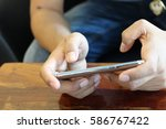 lady hand with touch screen... | Shutterstock . vector #586767422