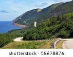 The winding highway of the world famous Cabot Trail along the coast of Cape Breton, Nova Scotia - stock photo