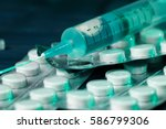 medical syringe on table with... | Shutterstock . vector #586799306