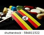 ugandan flag with lot of... | Shutterstock . vector #586811522