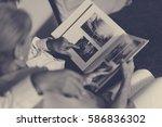 senior couple look photo album | Shutterstock . vector #586836302