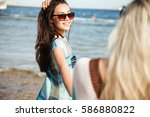 view from back of girl with her ... | Shutterstock . vector #586880822