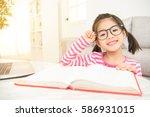 happy child little asian girl... | Shutterstock . vector #586931015