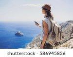 hiking woman using smart phone  ... | Shutterstock . vector #586945826