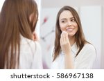 young attractive woman looking... | Shutterstock . vector #586967138