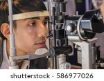 young asian man looking at eye... | Shutterstock . vector #586977026
