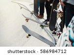 skaters ride skateboards on... | Shutterstock . vector #586984712