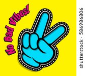 victory gesture. hand victory... | Shutterstock .eps vector #586986806