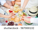 glass of white wine on picnic... | Shutterstock . vector #587000132