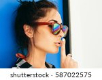 close up of a stylish hipster... | Shutterstock . vector #587022575
