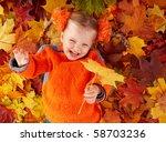 Little girl in autumn orange leaves. Outdoor. - stock photo