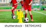 soccer ball and pylons on grass.... | Shutterstock . vector #587041442